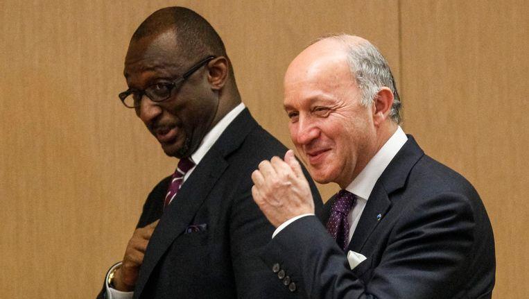 Archieffoto van Tieman Hubert Coulibaly (links) met zijn Franse collega Laurent Fabius.