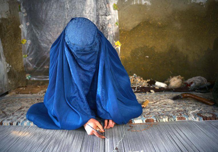 Een Afghaanse vluchtelinge in Iran. Beeld afp