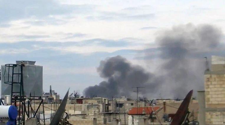 Rook stijgt op boven Homs. Beeld ap