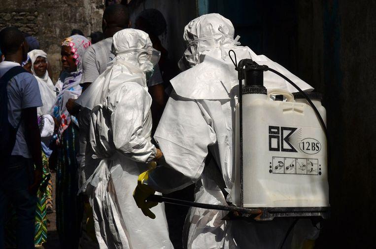 Ebola-bestrijders in Monrovia. Beeld afp