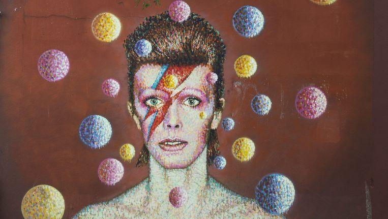 Een portret van David Bowie in Londen. Beeld epa