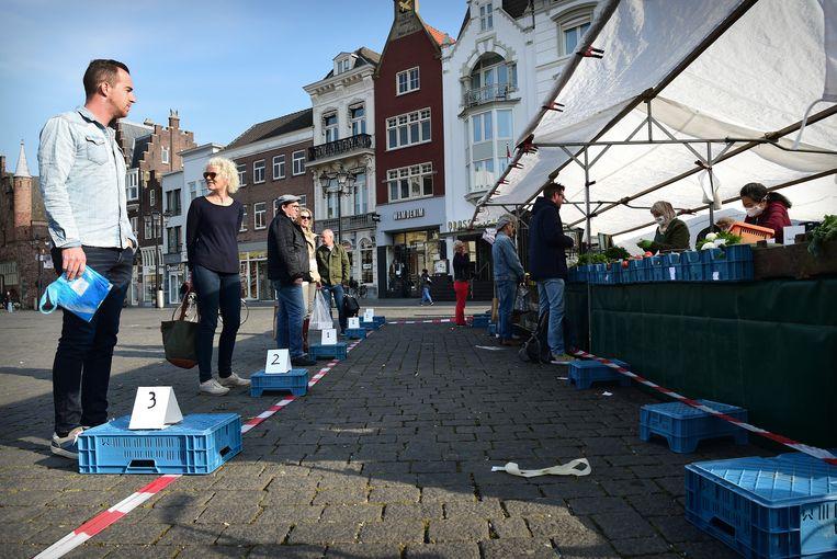De markt in Den Bosch.  Beeld Marcel van den Bergh / de Volkskrant