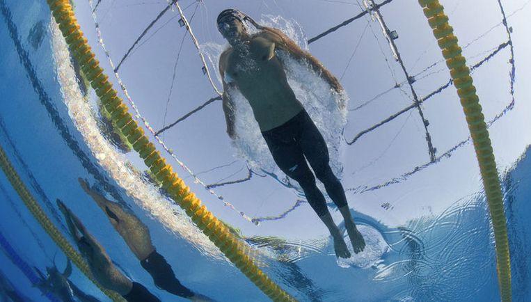 Op het door de pakkengekte getroffen WK klopte Phelps (foto) woensdag in de eindstrijd onder meer de in een full bodysuit van Arena gestoken Pool Pawel Korzeniowski. Foto EPA Beeld