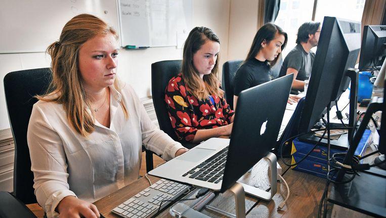 Medewerkers van oppasbedrijf Charly Cares. Beeld Guus Dubbelman / de Volkskrant