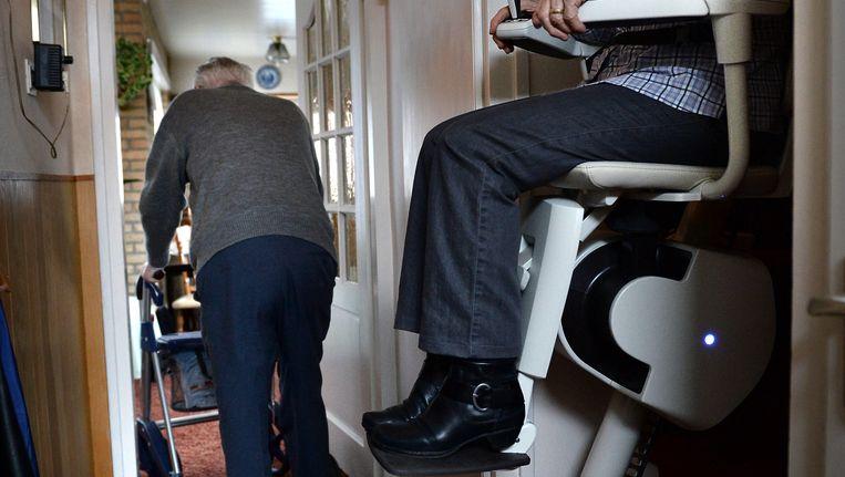 Een traplift. Beeld Marcel van den Bergh / de Volkskrant