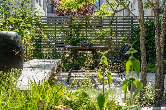 De bewoners van dit oude pakhuis in Gent hadden één wens: een groene oase.