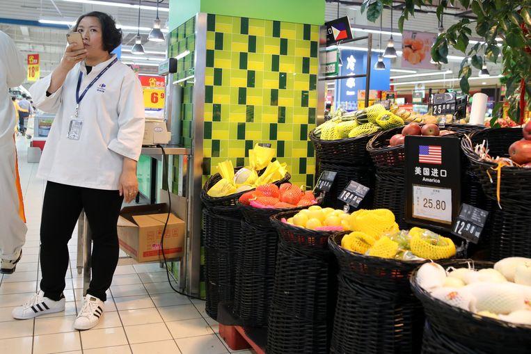 Producten uit de Verenigde Staten in een supermarkt in Beijing.  Beeld EPA