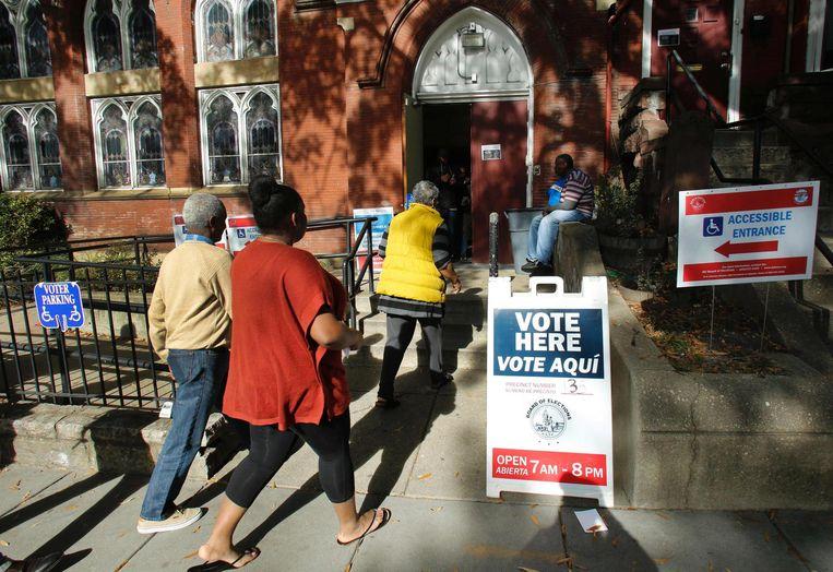 De ingang van een stemlokaal in Washington DC. Beeld AFP