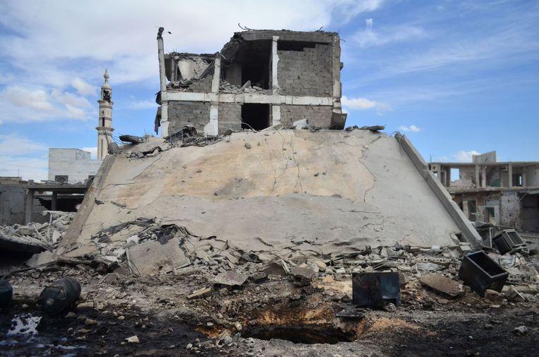 De ravage na de luchtaanvallen op de Syrische stad Talbisseh in de provincie Homs. Beeld afp