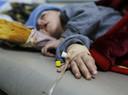 Een kind met cholera in een hulpcentrum in Sanaa, Jemen.