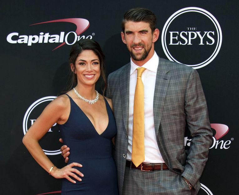 Phelps vorig jaar in juli met zijn vrouw Nicole Johnson.