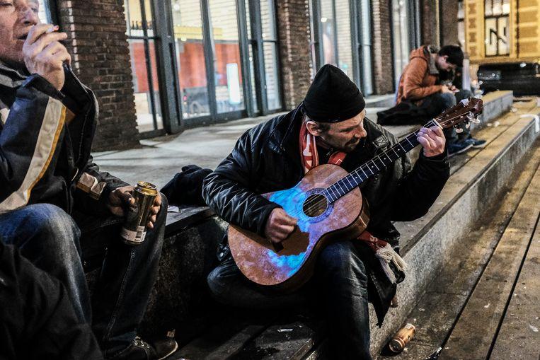 Poolse daklozen in Amsterdam.   Beeld Joris Van Gennip