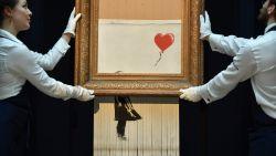 """VIDEO. Banksy wilde kunstwerk bij veiling volledig vernietigen: """"Mechanisme haperde"""""""