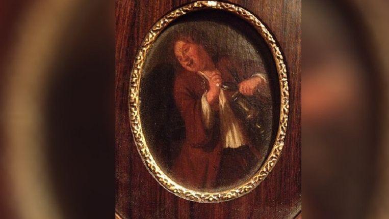 Het schilderijtje toont een vrolijke, drinkende man. Beeld Houtwyck Taxaties VOF