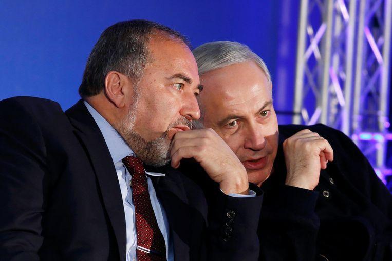 Premier Benjamin Netanyahu en Avigdor Lieberman. Beeld reuters