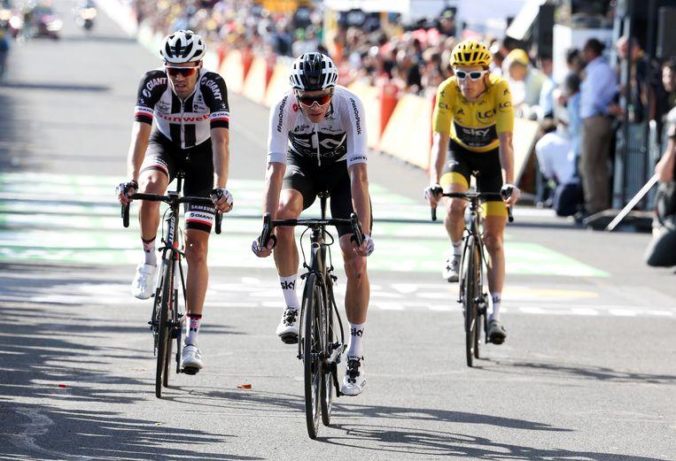 Chris Froome, Tom Dumoulin en Geraint Thomas bij de finish. Beeld Getty Images