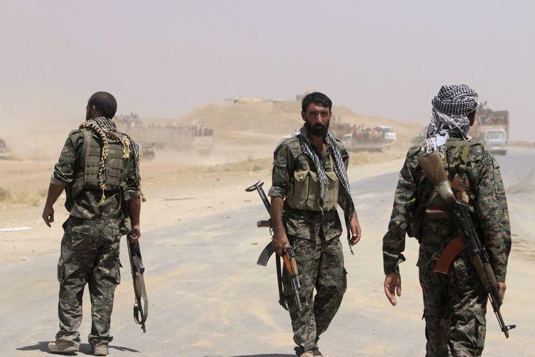 Koerdische strijders op de grens tussen Irak en Syrië. Beeld reuters