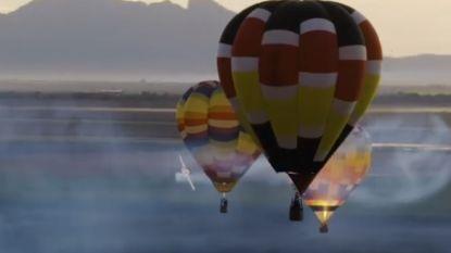 VIDEO. Stuntpiloot vliegt tussen luchtballonnen