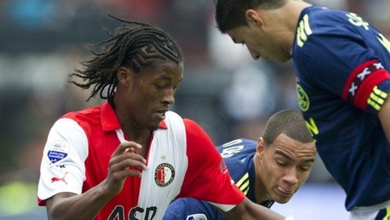 Georginio Wijnaldum van Feyenoord in duel met Gregory van der Wiel en Luis Suarez van Ajax. Foto ANP Beeld