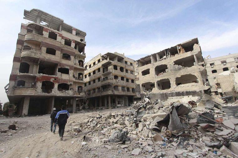 Schade in de Jobar-buitenwijk van Damascus Beeld reuters