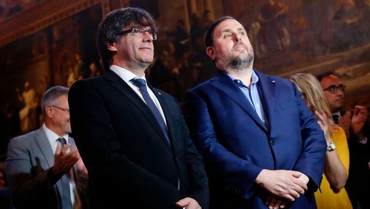 Catalaanse president Carles Puigdemont (links) en vice-president Oriol Junqueras (rechts).