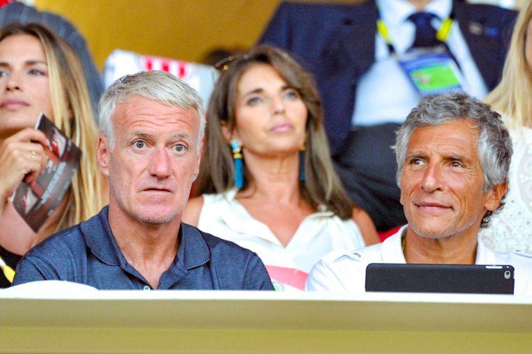 Deschamps met Nagui in het Stade Louis II tijdens Monaco - Lille. Op de achtergrond -de brunette- Claude, de vrouw van de Franse bondscoach.