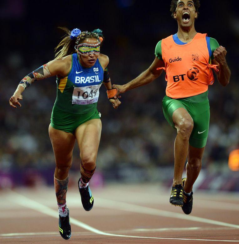 Terezinha Guilhermina tijdens de finale van de 100 meter op de Paralympische Spelen in Londen. Beeld afp