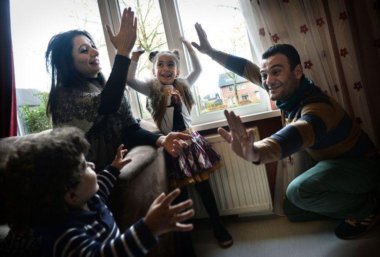 Hovsep Khachatryan en zijn gezin in hun woning in Boxmeer. Beeld Marcel van den Bergh
