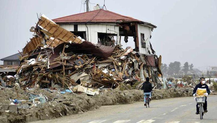 Beelden van de verwoesing in het door de aardbeving en tsunami getroffen gebied in Japan. Beeld reuters