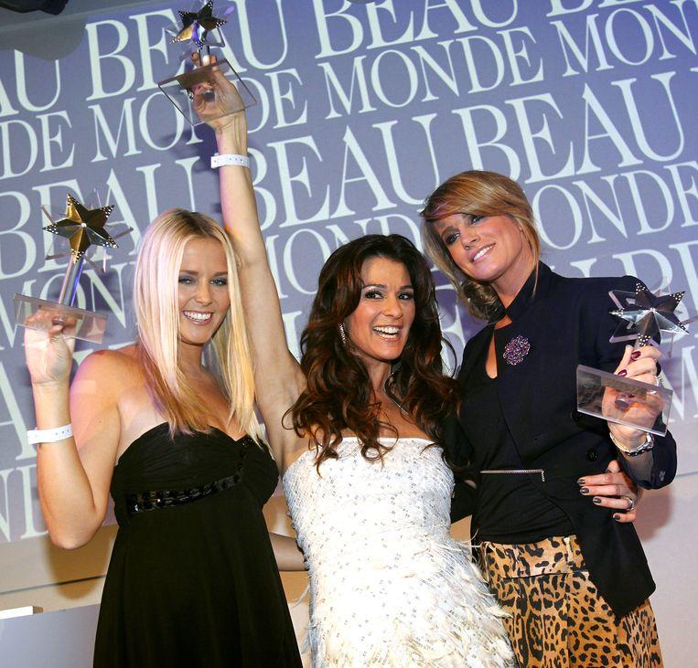 Drie winnaressen van de Beau Monde Awards. Rechts stijl-icoon Danielle. Beeld null