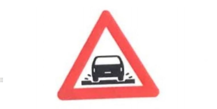Dit verkeersbord moet mensen waarschuwen voor tramsporen.