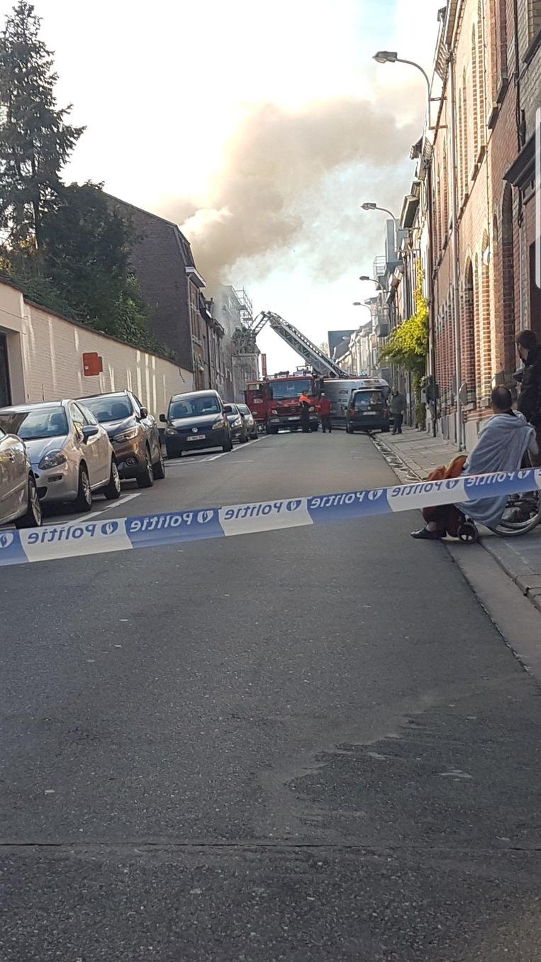 De politie hield kijklustigen op ruime afstand