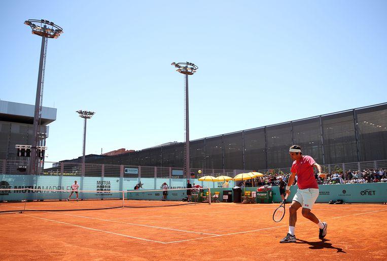 Roger Federer werkte zaterdag op zijn gemak een training af. Beeld Getty Images