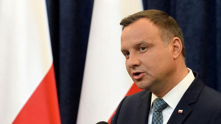 De Poolse president Andrzej Duda kondigt aan dat hij zijn vetorecht inzet tegen twee omstreden weten. Beeld afp