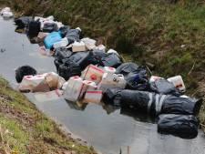 Drugsdumping in Eindhoven: vaten en afvalzakken in stroompje gelazerd