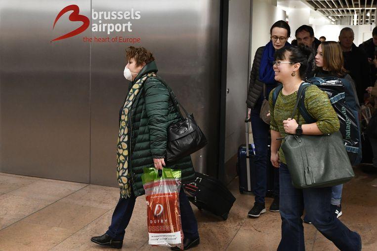 Passagiers arriveren op Brussel Airport.   Beeld BELGA
