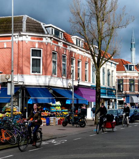 Grote menigte bemoeit zich met arrestatie van vrouw (19) uit Ede in Utrechtse Kanaalstraat