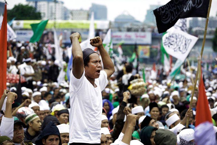Eind februari: islamistische demonstranten betogen tegen Ahok, de christelijke gouverneur van Jakarta die de Koran zou hebben beledigd. Beeld AP