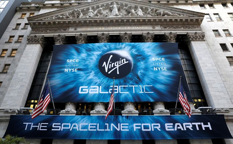 FILE PHOTO: A Banner hangs outside the New York Stock Exchange (NYSE) ahead of the Virgin Galactic (SPCE) IPO in New York, U.S., October 28, 2019. REUTERS/Brendan McDermid/File Photo
