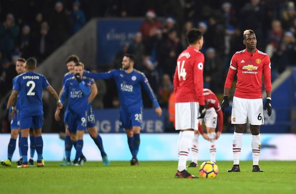 LEICESTER, ENGLAND - DECEMBER 23: Paul Pogba (R) of Manchester United looks dejected after the opening goal scored by Jamie Vardy of Leicester City during the Premier League match between Leicester City and Manchester United at The King Power Stadium on December 23, 2017 in Leicester, England.  (Photo by Michael Regan/Getty Images)
