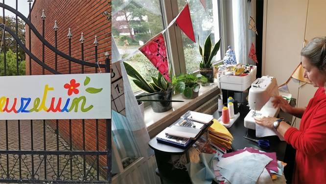 Vrijwilligers verkopen vlaggetjes om picknickbanken voor De Reuzetuin te kopen