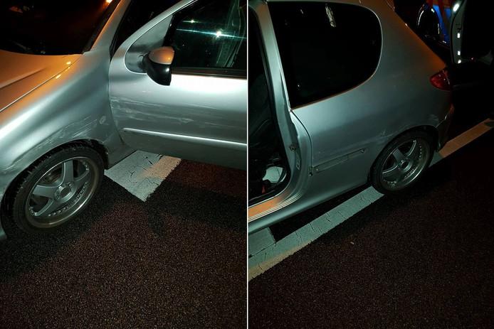 De schade aan de auto van de vrouw.