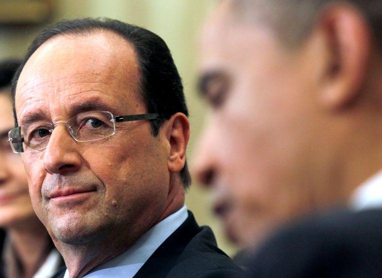 De Franse president Francois Hollande luistert naar Obama (archieffoto). Beeld ap