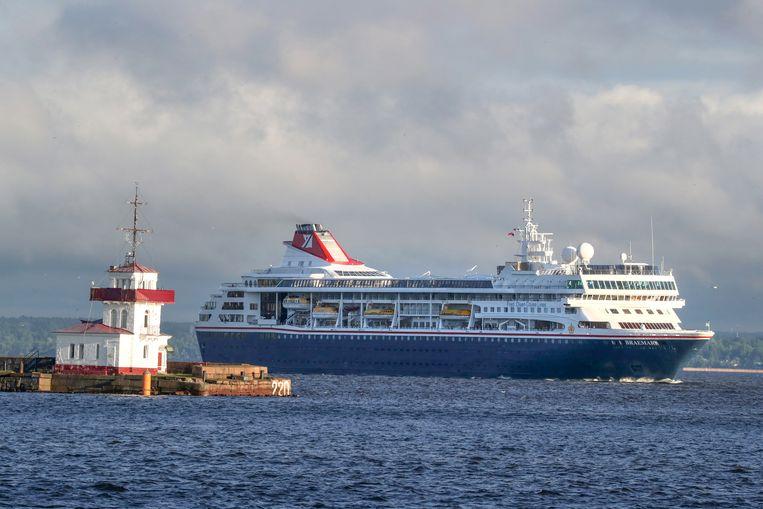 Cruiseschip MS Braemar, op deze foto in St Petersburg, ligt nu in de haven van Willemstad met vijf besmette passagiers aan boord. Beeld Peter Kovalev/TASS