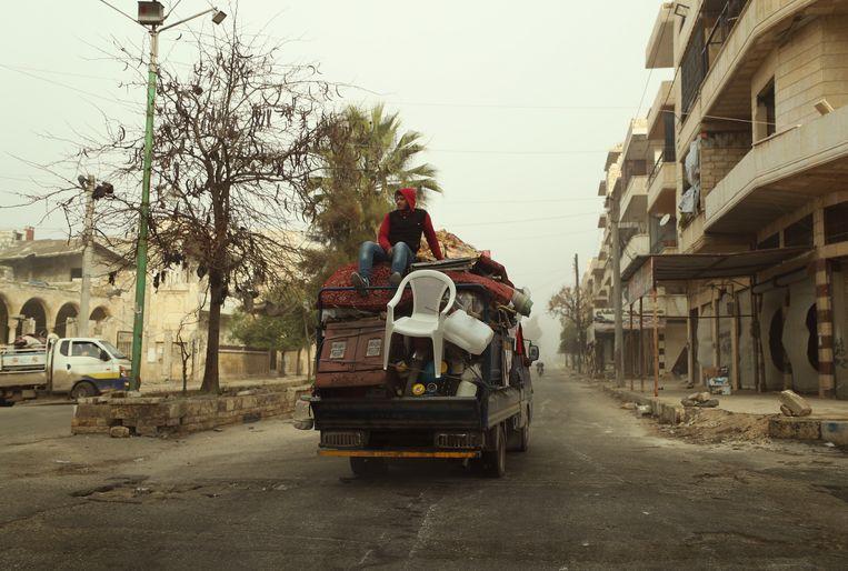 Al duizenden mensen zijn de stad Maarat al-Numan ontvlucht. Beeld AFP