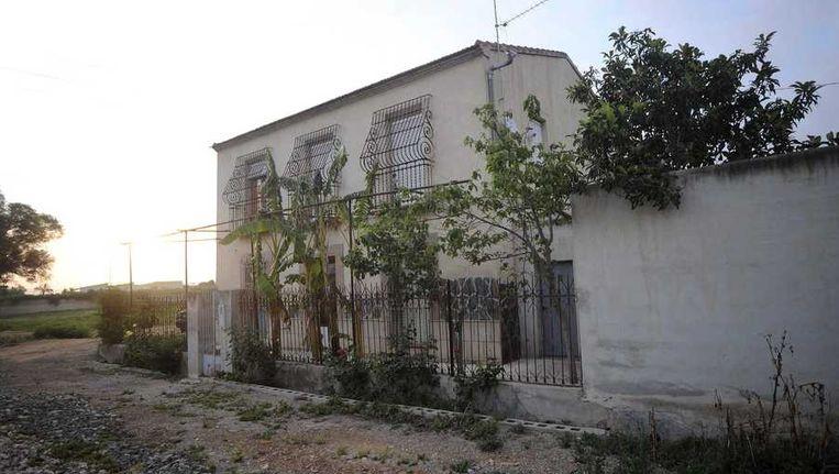 De citroenboomgaard in Alquerías, ongeveer 12 kilometer van Murcia, waar de Spaanse politie de lichamen heeft aangetroffen. Beeld epa