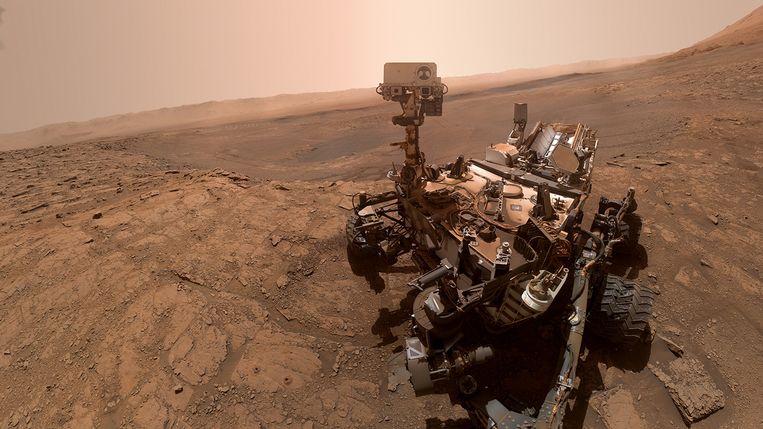 Selfie van Marswagen Curiosity. De Amerikaanse marsrobot verkent sinds 2012 het oppervlak van de rode planeet. Beeld NASA