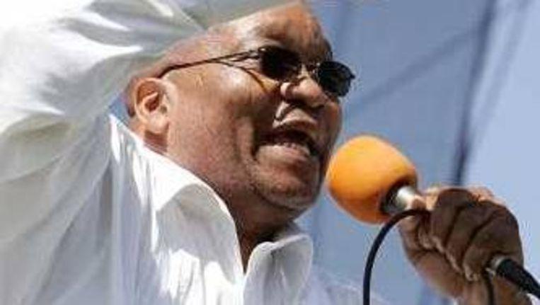 President Jacob Zuma tijdens een bijeenkomst in Khayelitsha, Zuid-Afrika op 22 februari 2009. (AP Photo/Schalk van Zuydam) Beeld