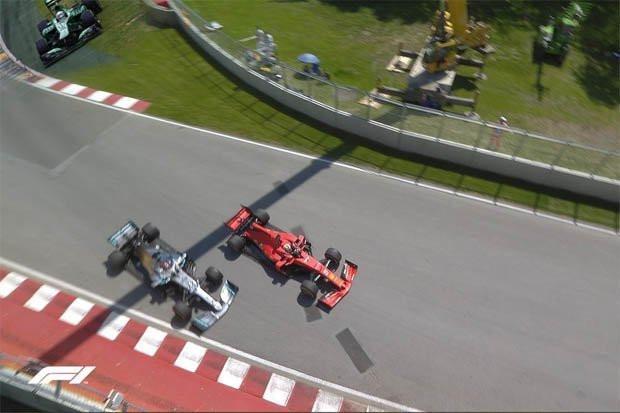 Sebastian Vettel (r) snijdt Lewis Hamiltonn af in GP van Canada.