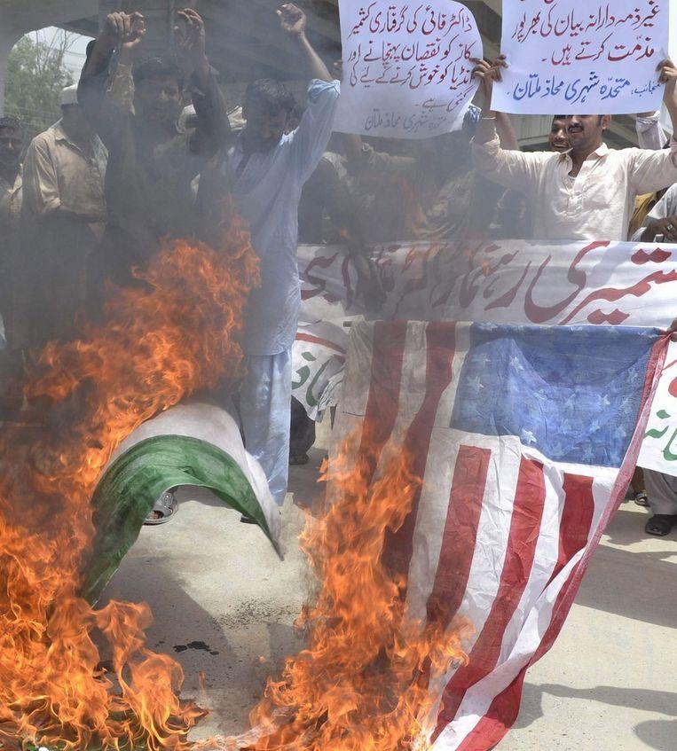 Protest in Pakistan wegens de arrestatie door de FBI van een in Kashmir geboren Amerikaanse burger. Beeld epa